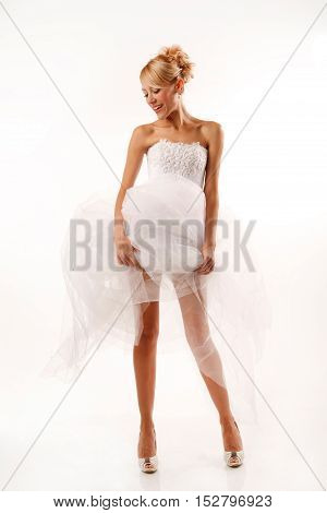Fascinating standing bride with long legs .Isolated on white
