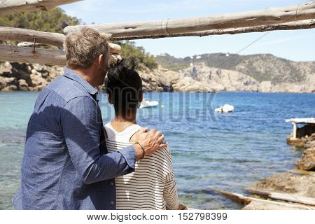 Middle aged African American woman at a table by the sea