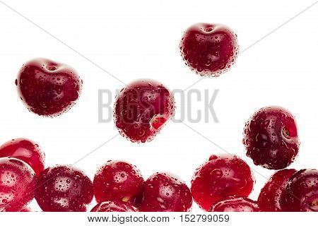 Berries ripe fresh cherries on a white background. Isolated. Cherry background. Macro. Decorative frame. Fruit background.