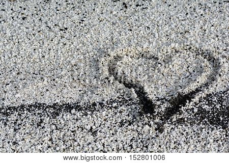 Hearth draw on little rocks. Close up image.