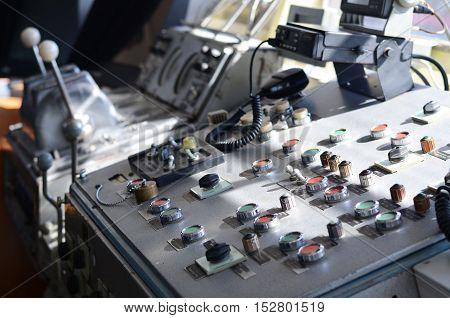 the captain's control bridge on a ship