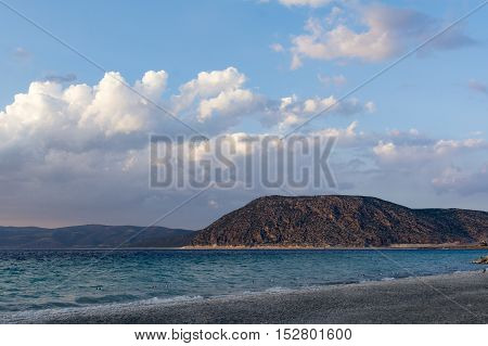 Mountains ans sea under cloudscape with blue sky