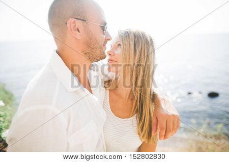 Happy romantic fashion couple in love have fun on beautiful sea at summer day.