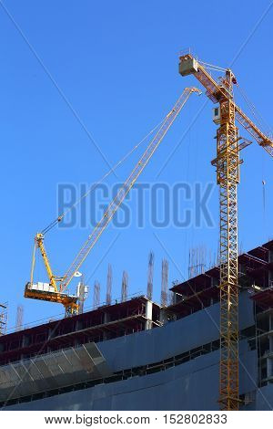 Construction Site Building Industry With Two Machinery Crane Working