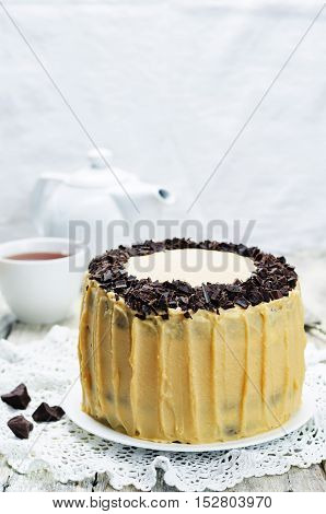 Pumpkin and chocolate layer cake with salted caramel cream cheese frosting.