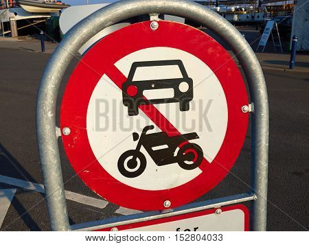 Prohibitory traffic sign the passage of motorcycles scooters and cars prohibited