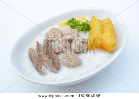 Congee with pork and ginger slices on top Rice porridge with pork