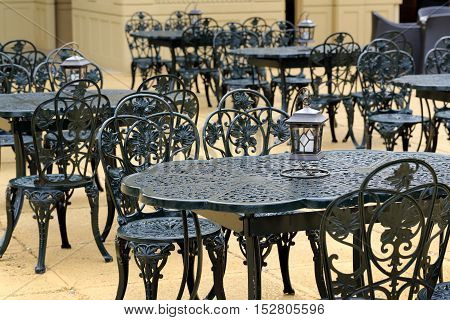 Empty cafe on the terrace, without guests, chairs and tables, selective focus