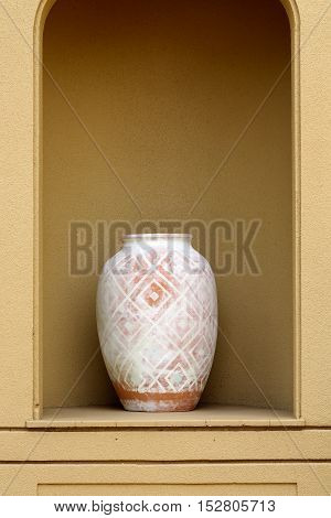 Antique earthen jar on wall background copy space concept antique