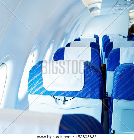 Inside the plane, empty seats and windows.