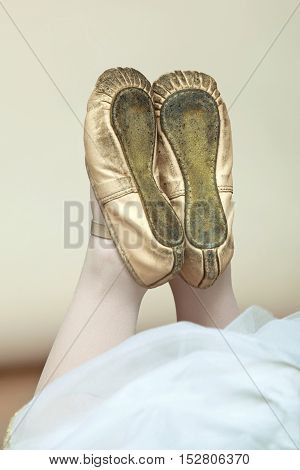 Close up of ballerina's legs in pointe.
