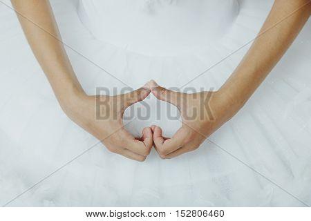 Closeup of ballerina's hands as a hard shape
