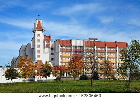 Grodno, Belarus - October 13, 2016: Multistory building of the nursing home with a tower balconies and red roof in Grodno in the autumn.