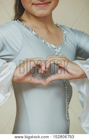 Closeup of dancer's hands as a hard shape.
