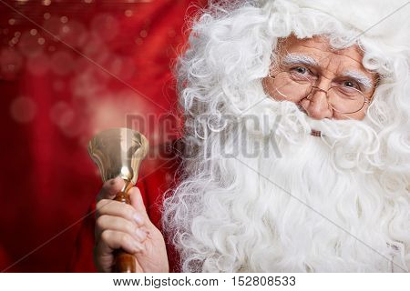 traditional Santa Claus ringing on a bell, concept coming Christmas