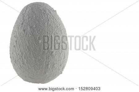 A white egg of stone on a white background.