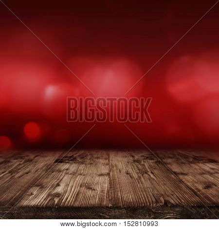 Abstract background in red for Valentine's Day in front of an empty wooden table