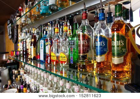 Blurred Alcohol Bottles On A Bar