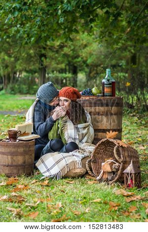 Romantic happy couple at fall in the autumn garden