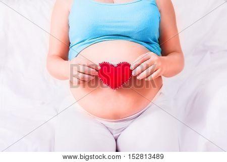 Pregnancy. Pregnant woman's belly Health. Medicine. Healthy life