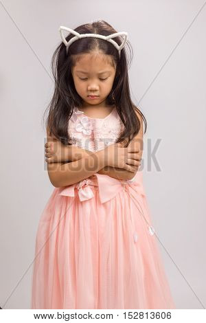 Kid With Cat Ear Headband In Pink Dress, Isolated On White