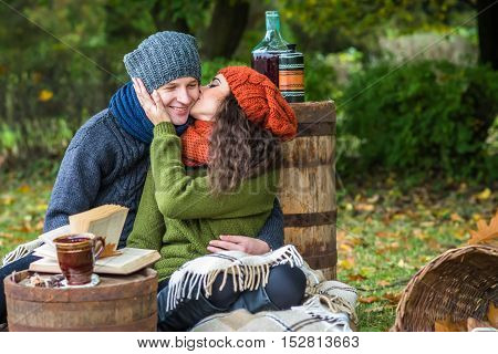 Romantic happy couple at fall couple kissing in autumn garden