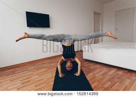 Fit woman doing yoga on mat at home in the bedroom.A series of yoga poses. lifestyle concept