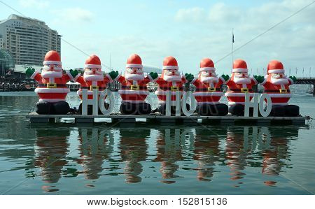 A bunch of inflated Santa Claus are decorating the Darling Harbour area in downtown Sydney during the Christmas holidays.