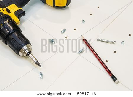 marking, drilling and production of furniture, accessories and tools close up