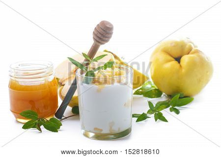 Greek yogurt with roasted quince and honey on a white background