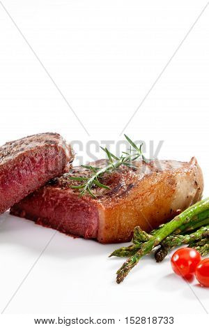 close  up view of nice yummy fresh steak  with vegetables on white back