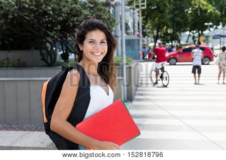 Cute caucasian female student outdoor in the city in the summer