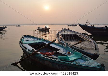 Sunrise with boats on river Ganga, Varanasi, India