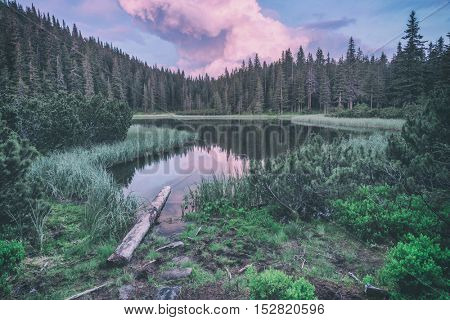 lake in mountain on summer time, toned like Instagram filter