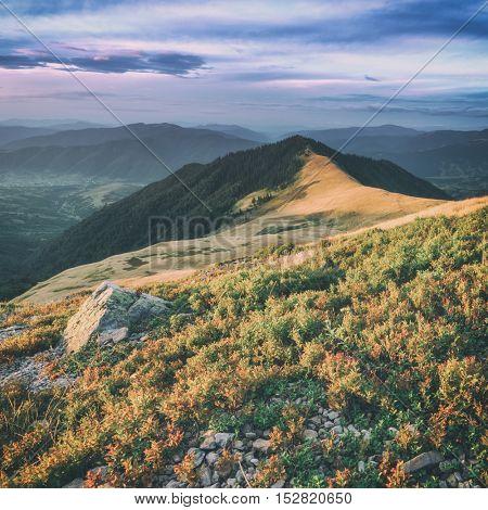Beautiful Carpathian mountains in autumn time. Pishkonia range, Ukraine, Europe, toned like Instagram filter