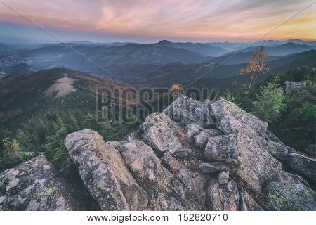 View of the stony hills glowing by evening sunlight. Dramatic autumn scene. Yavirnuk ridge, Carpathians, Ukraine, Europe, toned like Instagram filter
