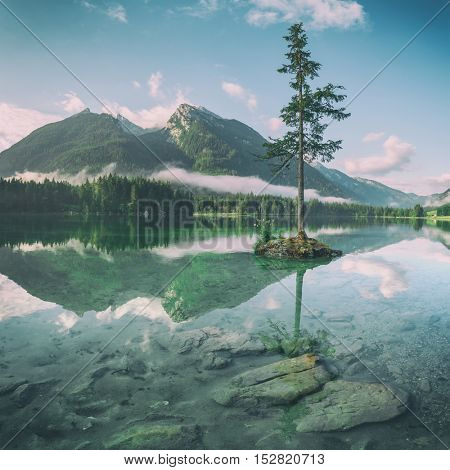 Amazing sunny summer day on the Hintersee lake in Austrian Alps, Europe, toned like Instagram filter