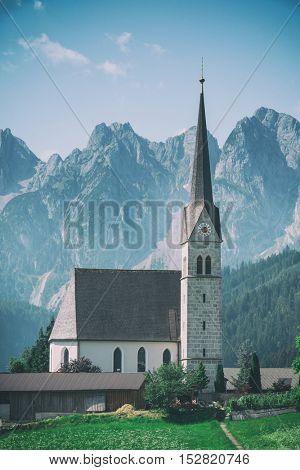 Christianity churh in Gosau village at sunny day. Alps, Austria, Europe, toned like Instagram filter