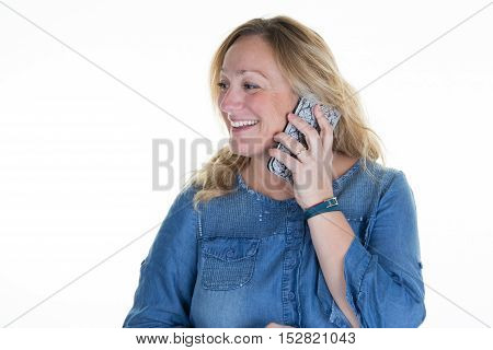 Middle Aged Blond Happy Woman With A Cell Phone Talking