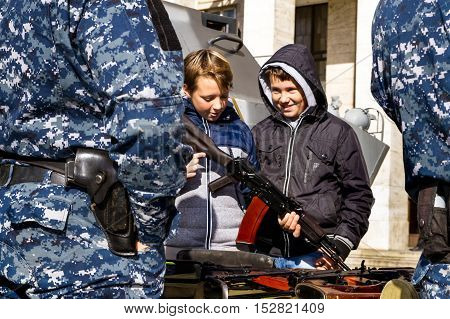 Uzhgorod Ukraine - 14 October 2016: Local students are considering an exhibition of small arms during the celebration of Defender of the Fatherland Day. This day Ukraine celebrates the Day of Defender of the Fatherland.