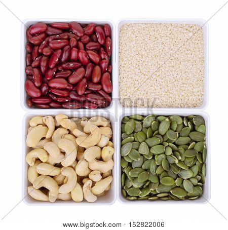 red beanwhite sesamePumpkin seedsCashew nuts in white square bowl isolated on white