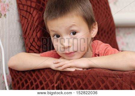 Caucasian cute boy portrait looking straight at you