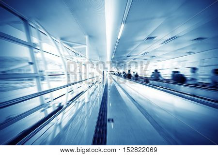blue motion of business passage escalator in airport