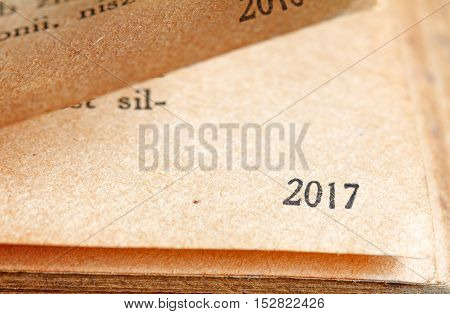 2017 new year numbers on the page of book background concept