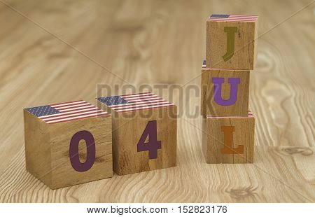 Cube shape calendar for July 04 on wooden surface with USA flag.