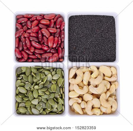 red beanblack sesamePumpkin seedsCashew nuts in white square bowl isolated on white