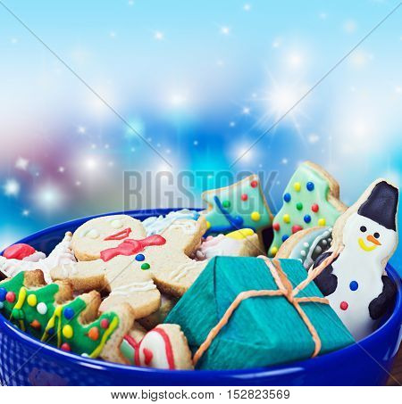 Christmas gingerbread cookies on a plate on a blue background