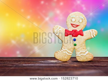 Smiling gingerbread men on a colored background