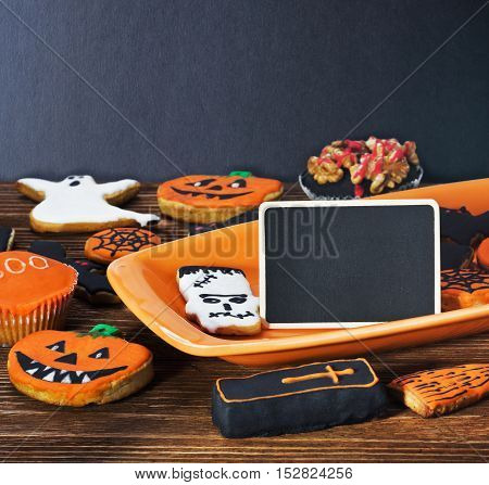 Halloween cookies on a plate orange and blackboard
