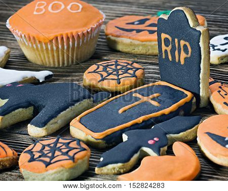 Handmade Halloween cookies on a wooden background
